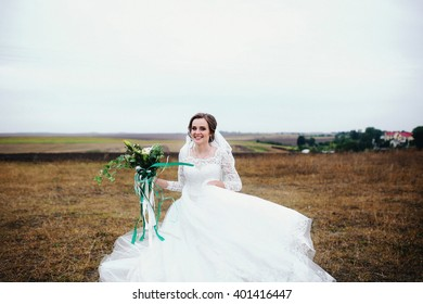 Amazing bride is turning around with the bouquet