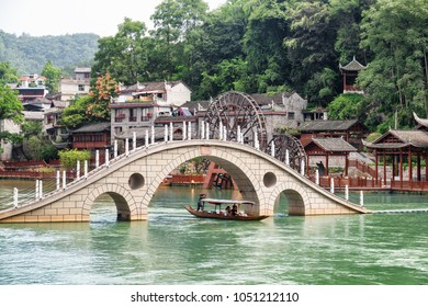 Amazing bridge over the Tuojiang River (Tuo Jiang River) in Phoenix Ancient Town (Fenghuang County), China. Fenghuang is a popular tourist destination of Asia.