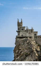 Amazing castle Swallow's Nest on a rock at the Black Sea, Crimea. Scenic panoramic view of Crimea southern coast. Architecture and nature of Crimea