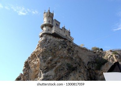 Amazing castle Swallow's Nest on a rock at Black Sea. It is a symbol and landmark of Crimea. Architecture and nature of Crimea.