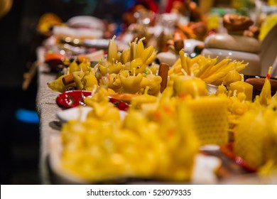 Amazing Christmas market with different yellow candles in Latvia