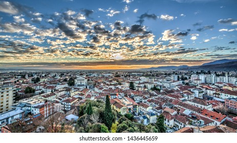 Amazing city panorama in cloudy dawn Schio, Italy