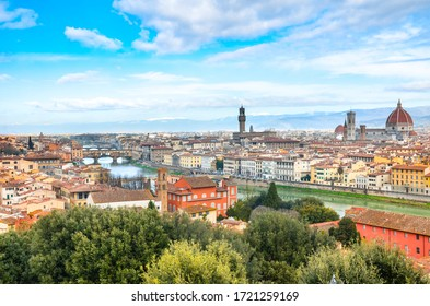 Amazing cityscape of Florence, Tuscany, Italy. Historical city center along Arno river with major sights Ponte Vecchio Bridge and Santa Maria Cathedral. Mountains in the background.
