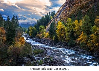 Amazing clouds and fall colors in autumn on the Icicle River in North Central Washington
