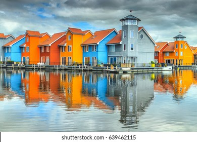 Amazing colorful buildings on water at haven, Groningen, Netherlands, Europe