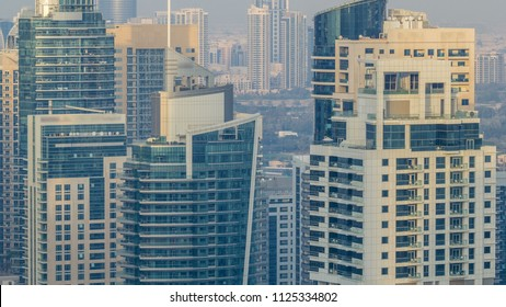 Amazing colorful dubai marina and JLT skyline during sunset timelapse. Great perspective of multiple tallest skyscrapers of the world. Sunlight over buildings. United Arab Emirates.