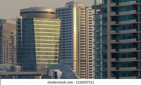 Amazing colorful dubai marina and JLT skyline during sunset timelapse. Great perspective of multiple tallest skyscrapers of the world with sun reflected on a glass. Sunlight over buildings. United
