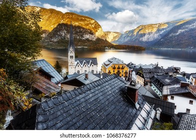 Amazing Colorful Foggy Sunset at Famouse Hallstatt Village. Impressively Beautiful Scene in the Hallstatter Lake. Hallstatt Luteran Crurch reflected in Trandil Water. Top places for photography