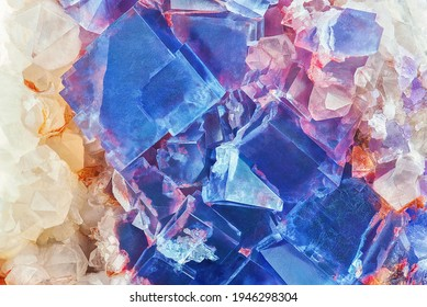 Amazing colorful macro closeup of blue or cobalt rare fluorite mineral specimen isolated as a background. Natural mineral gem stone (fluorspar). Natural cubic texture - Fluorite crystals detail