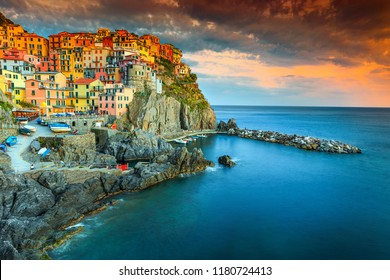Amazing colorful mediterranean sunset, fantastic panorama of Manarola touristic village in Cinque Terre National Park, Liguria, Italy, Europe
