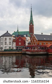Amazing colorful nordic wooden architecture in the old part of Arendal, view from the sea, Norway