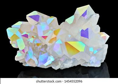 Amazing colorful Quartz Rainbow Flame Angel Aura Crystal cluster closeup macro isolated on black background