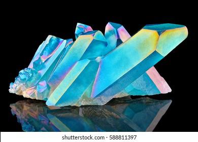 Amazing colorful Quartz Rainbow Flame Blue Aqua Aura crystal cluster closeup macro isolated on black background