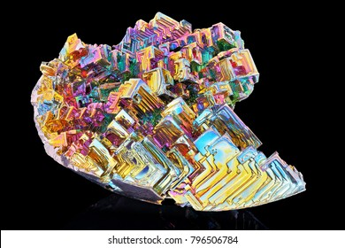Amazing colorful rainbow Bismuth Gemstone macro closeup isolated on black background