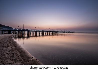 Amazing colorful sunrise over the pier in Gdynia Orlowo. Sunrise