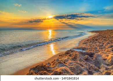 Amazing colorful sunrise over the Polish Baltic Sea. Beautiful golden sunset hdr over sea with reflection, Morze Bałtyckie - Shutterstock ID 1491841814