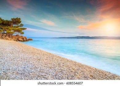 Amazing colorful sunset over the beach, near Brela, Makarska riviera, Dalmatia, Croatia, Europe