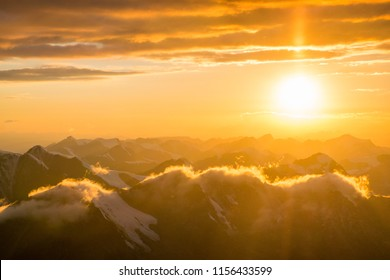 Amazing colorful sunset over mountain with rocks and ice in Tian Shan mountains in Central Asia near Almaty in cloudy weather. Best place for active life, climbing, hiking and trekking in Kazakhstan.