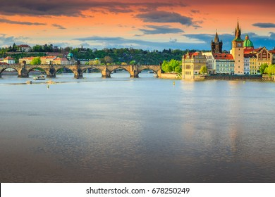 Amazing colorful sunset and spectacular cityscape with old stone Charles bridge in Prague, Czech Republic, Europe