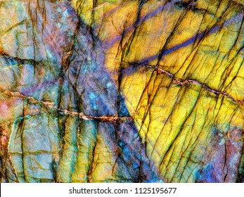 Amazing colorful texture of iridescence Labradorite Mineral gemstone background macro close-up. Beautiful reflective shiny Crystal