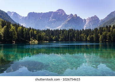 Amazing colors of alpine lakes Fusine park and beautiful reflections on water surface. Tarvisio (Udine) Friuli Venezia Giulia, Italy