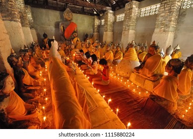Amazing coral Buddha under the candle light Buddhists and tourists come to pay homage at Wad Sumret temple on Koh Samui Surat Thani province Thailand 2008 2nd of April