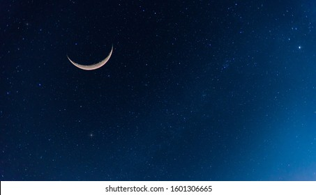 Amazing Crescent Moon on dark blue night sky background.Universe filled with stars, nebula and galaxy with noise and grain.selection focus.