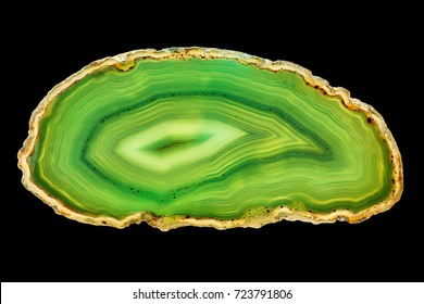 Amazing cross section of Green Agate Crystal cut isolated on black background. Natural translucent agate crystal surface, Green abstract structure slice mineral stone macro closeup