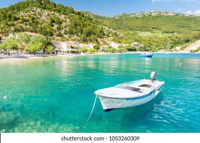 amazing crystal clear sea with boat and beach in Peljesac peninsula, Dalmatia, Croatia