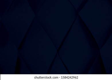 Amazing dark deep blue abstract rhombus texture background. Play of light and shadows. Convex and concave parts of figure.