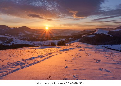 Amazing dawn. Winter sunrise in the hills mountains.