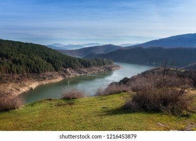 An amazing day view of Studen Kladenetz dam and a bridge over it, which is situated in Eastern Rhodopes Mountains, Bulgaria
