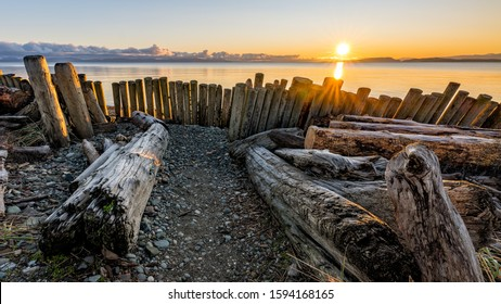 Amazing December sunrise at Goose Spit Regional Park on Vancouver Island in Comox Valley, British Columbia, Canada.
