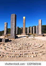 """Amazing design - 13 basalt pillars, one of which is covered with gold. Stonehenge in Ibiza. Spain. Place of power. Magic sculpture. Urban sculpture by Andrew Rogers Stonehenge """"Time and Space."""""""