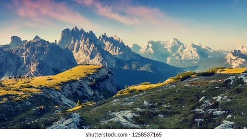 Amazing Dolomites Mountains Landscape with colorful sky. Great view of the top Cadini di Misurina range in National Park Tre Cime di Lavaredo. Dolomites, South Tyrol. Tre cime di Lavaredo.