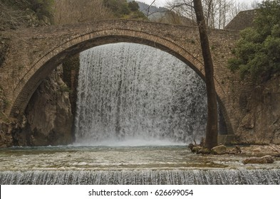 The amazing double waterfall and the famous stone bridge over Portaikos river at Paleokaria village near Trikala.  Greece.