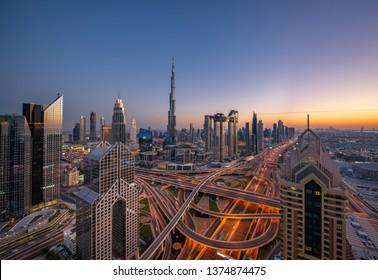 Amazing Dubai Downtown Aerial Panorama at sunset.  City center skyscrapers landscape. Beautiful futuristic megapolis concept. City of the future. United Arab Emirates