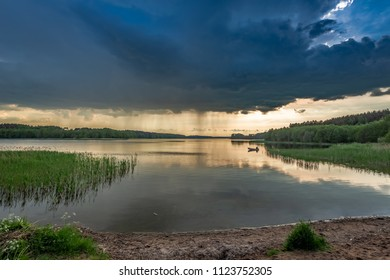 Amazing dusk at the summer lake with dynamic clouds