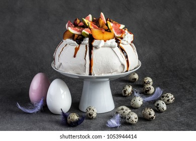 Amazing easter meringue with fresh fruits on grey and easter quail egg
