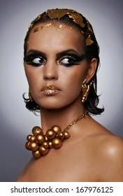 Amazing egyptian golden make-up style, portrait,smokey eyes,golden glamour, shiny, jewelry and art.