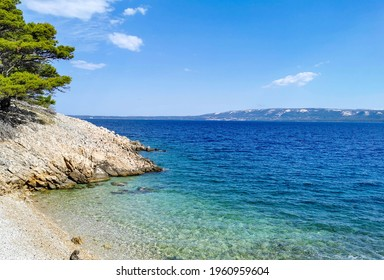Amazing empty beach on sunny day in summer  Beautiful cove in Lun, island of Pag, Croatia
