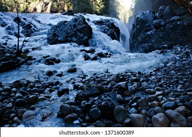 Amazing environment to observe high rate of water flow following after an abundance of rain fell in the past days gushing over granite rocks boulders then vanishing in a crevice flowing downstream