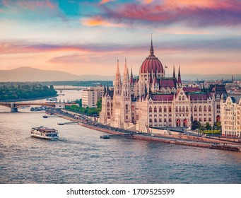 Amazing evening view of Parliament house. Stunning spring cityscape of Budapest. Great sunset in Hungary, Europe. Traveling concept background.