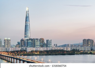 Amazing evening view of skyscraper at downtown of Seoul in South Korea. Beautiful modern tower and the Han River (Hangang). Wonderful cityscape. Seoul is a popular tourist destination of Asia.