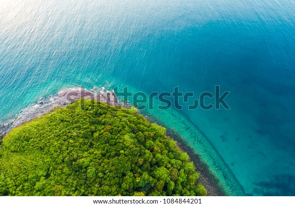 Amazing Exotic idyllic sea shore island with green tree forest aerial view