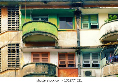 Amazing facade building with contrast color is green and red, antique flat with old architecture at Ho Chi Minh city, Vietnam, vintage wooden window and balcony round from house