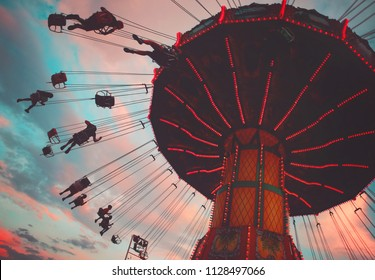 amazing fair photo with rides toned with a retro vintage instagram filter