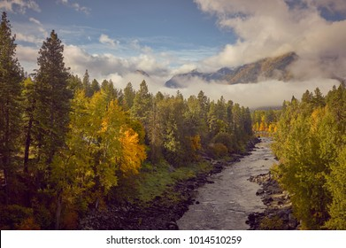 Amazing fall colors, blue sky and giant white clouds overlooking the Wenatche River outside of Leavenworth Washington