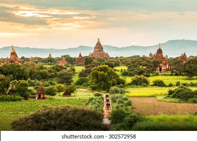 Amazing famous travel and landscape scene of ancient temples and carriages at sunset in Bagan, Myanmar. Top of the best destination of asia.