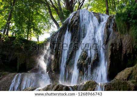 Amazing and Famous Waterfall in Lucky Spa Village, Slovakia, with Late Sun Glittering through Thermal Mineral Water